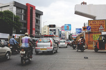 motorbikes and cars on a city street