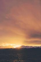ocean, water, snow, mountain peaks, mountains, outdoors, sky, sunset
