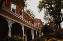 front porch of an historic brick home