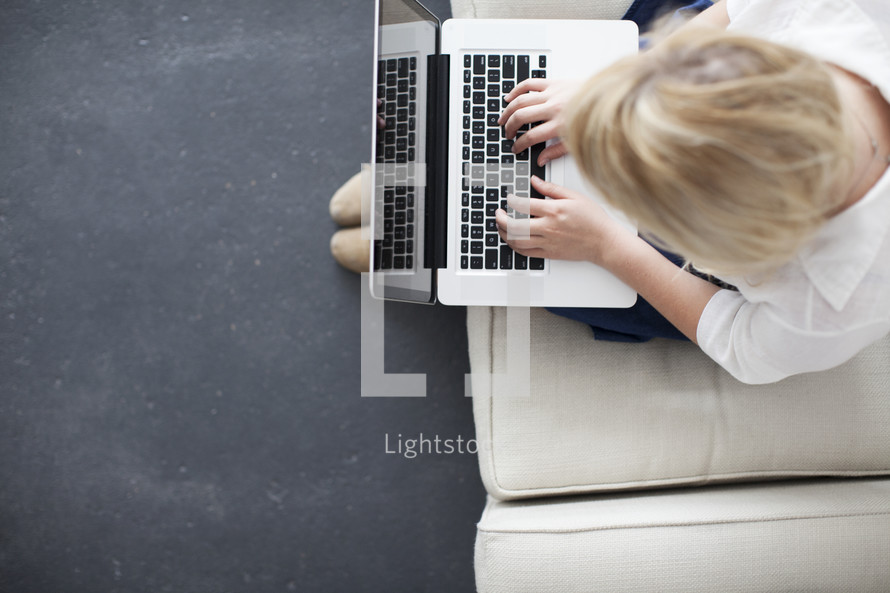 Student girl typing on a laptop