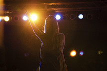 Woman leading worship.