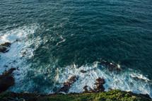 Ocean waves crashing against rocks.