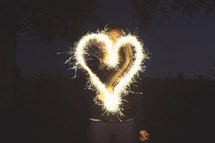 sparkler forming a heart at night.