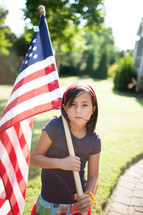 child holding an American flag