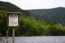 Anglers fly fishing only sign