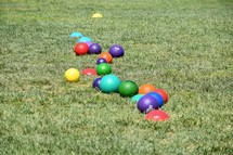 colorful dodgeballs in grass