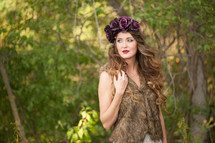 woman in a fur vest and flower hat