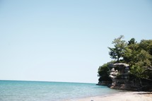 cliffs along a coastline and beach