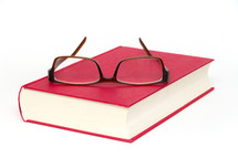 reading glasses on a book