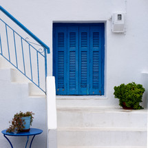 white steps and blue doors