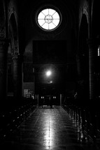 aisle and pews in a dark cathedral