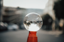 cityscape through a glass orb