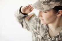 Female soldier in uniform saluting.