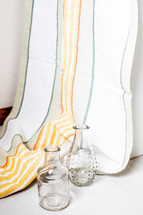 glass vases and striped curtain