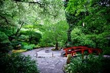red bridge in a garden
