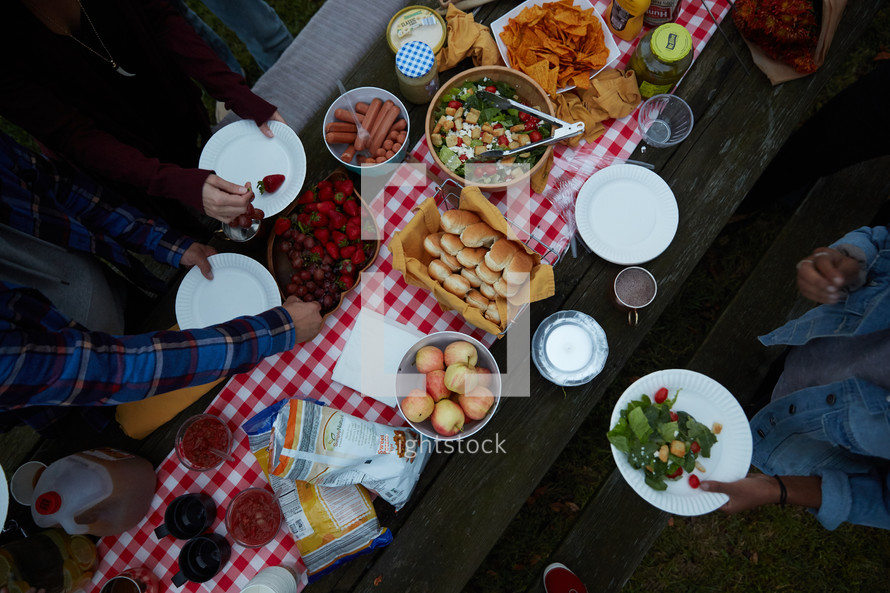food on an outdoor table for a party