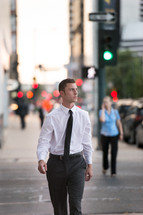 a business man walking down a city street