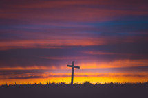 a cross at sunrise