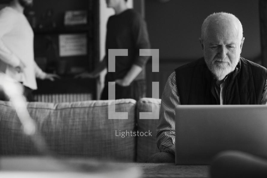 man looking at a computer screen