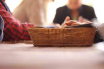 prayer around a basket