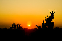 silhouettes of children at sunset in Africa