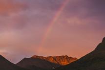 a rainbow over a mountain
