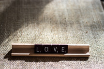 word love in scrabble pieces