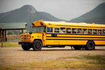 school bus parked at a lake