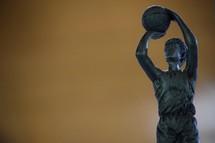 A basketball trophy against orange background