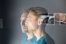 Double exposure of the side profile of a man
