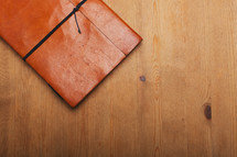 leather journal on a table