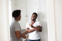 friends talking in a kitchen