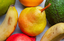 Pear, orange, red apple and banana are mixed tasty fruit composition on background fruit health food