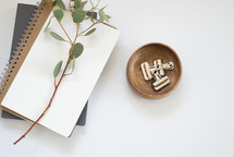 eucalyptus twig, journal, bowl, paper clasps, and coffee cup