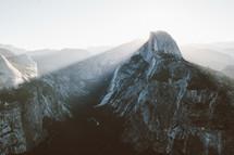 sunlight shining on mountain peaks