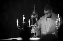 Priest preparing communion at an altar