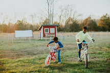 kids riding bikes on a farm