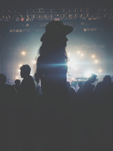 silhouettes of audience members at a concert