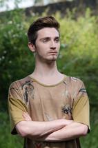young man posing outdoors