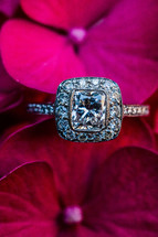 An engagement ring among purple red flowers square solitaire diamond wedding vintage platinum