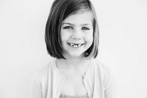 girl child with missing teeth smiling