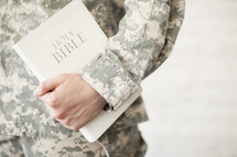 soldier holding a Holy Bible