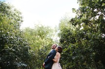 bride and groom standing in a jungle