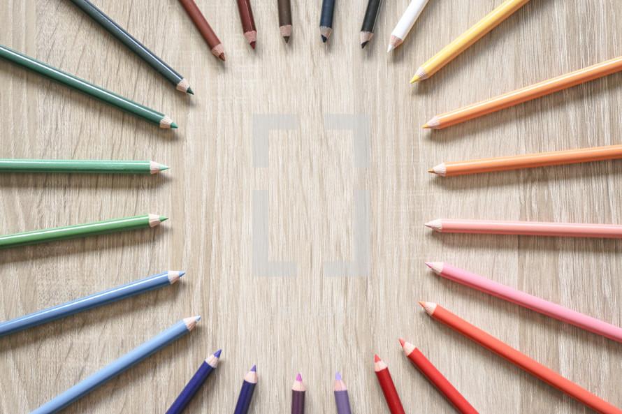 circular border of colored pencils