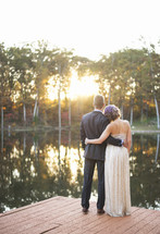 bride and groom standing on a dock