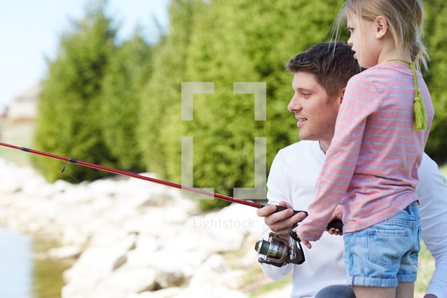 a father fishing with his children