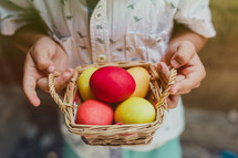 a boy holding an easter basket