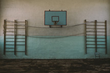 basketball goal and ladders on a wall