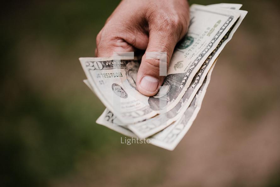 a man holding cash