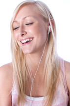 teen listening with earbuds